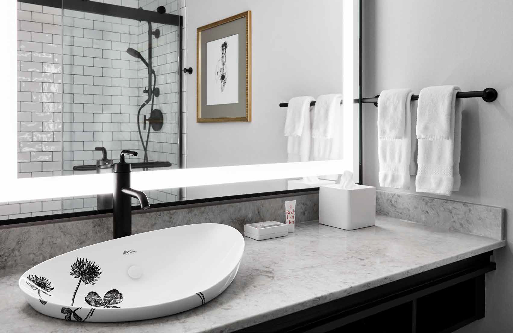 Partnering with Kohler on a full bathroom specification—including Matte Black accessories and small-batch custom Artist Editions sinks—provided the Saint Kate design team an artful way to underscore their project with a sense of style and distinction.