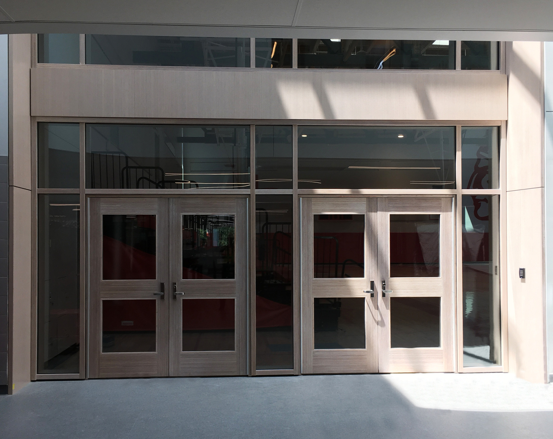Featured here at Saugus Middle/High School is the combination of Lamboo® Vue™ Series - Curtain Wall System and Lamboo® Vue™ Series - Commercial Doors.