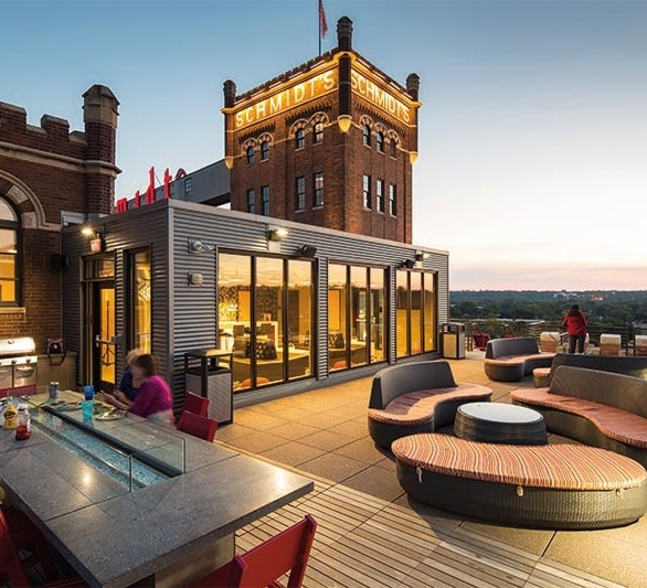 The rooftop patio at the Schmidt Artist Loft features modern furnishings and stunning views.