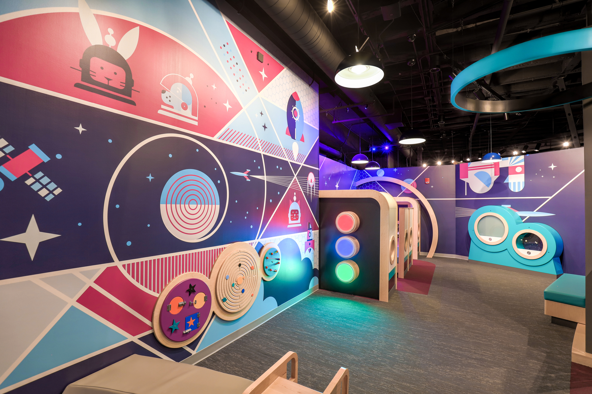 Bright graphic wall art and custom lighting will keep your kids attention at the Museum of Natural Science.
