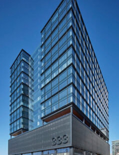 The recently opened GR333N building at 333 North Green St. in Chicago features the largest wind-driven flapper wall system of its kind. The kinetic façade creatively covers the parking garage on the lower levels. Above it, a curtainwall offers daylight and views for the office and retail floors of this LEED Gold-certified, 19-story mixed-use building.  Photo credit: Tom Harris Photography