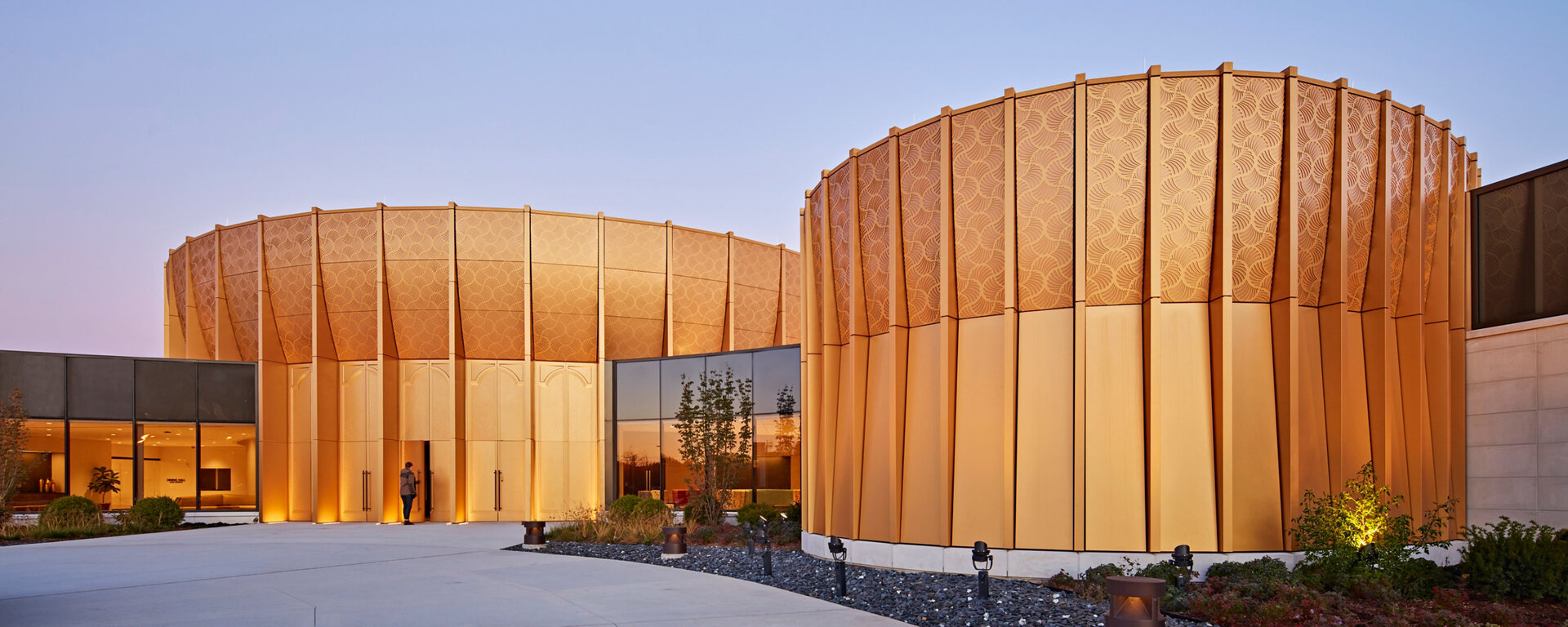 The approved Sherwin Williams Fluropon Classic II Light Gold and Dark Gold colors for Science of Spirituality's new Center were formulated using mica flake to enhance the vibrancy of the finished panel system.  Photo Credit: ©Tom Harris by Gensler