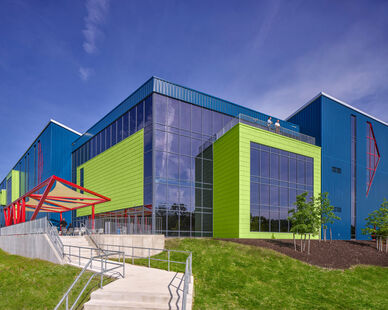 Both wall cladding systems were factory-finished by a single, qualified applicator, Metal Coaters. This allowed for greater quality control in applying Fluropon Pure's specially formulated, durable, architectural coatings. The vibrantly colorful, sustainable finished, and precisely formed panels require minimal maintenance. They offer a lifespan of 40 years or more and can be recycled at the end of their useful life on SEI's Valley View building.