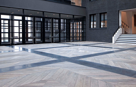 Simply Oak™ hardwood floors in Wye are featured here in this sleek and modern lobby.