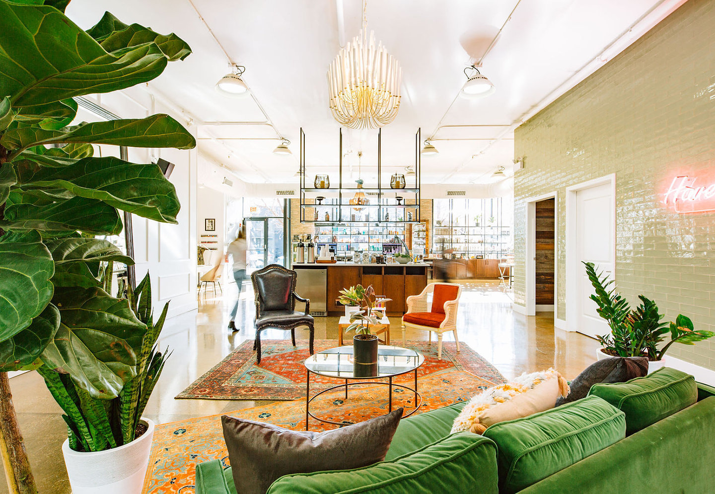 "The Solo Salon's lobby features an inviting green velvet sofa with a layered vintage Oriental rugs (a Siren Betty signature) they add a bit of ""Gypsy"" to this Elizabeth Street Salon."