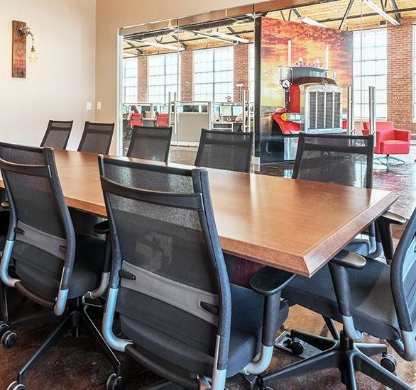 Spacious conference room at Blue Bloodhound Offices with dynamic seating by SitOnIt Seating.