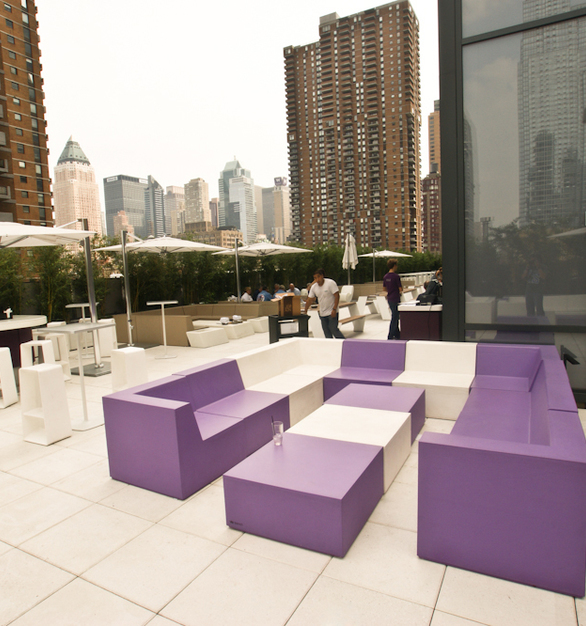 SIXINCH furniture brings out bold colors while creating this iconic space at Yotel, a hotel in NYC.