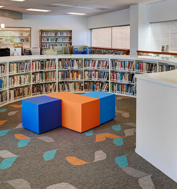 SIXINCH coated furniture is a durable option for any library or educational space. Pictured is La Jolla Country Day School in California by Ware Malcomb.