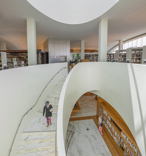 """The structural glass wall needed a special part called a """"Donut."""" It was bought from Sadev in Chicago , delivered to Cristacurva in Mexico, and ended up part of a library in Costa Mesa!"""