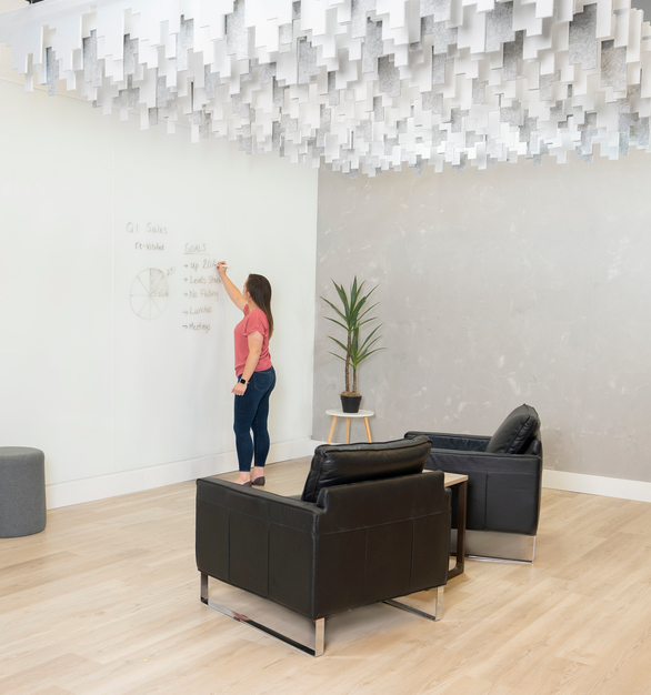 The Skyline Baffle Ceiling System adds style to an open office space, while also providing sound reducing acoustics.