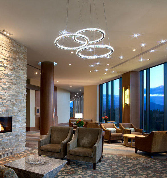 Stunning Circle and StarLED Deluxe lighting by Swarovski Lighting in a lounge area of Sparkling Hills Hotel.
