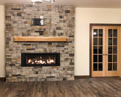 Townhome fireplaces provide a welcoming environment and eye-catching design with thin brick systems by Speedymason.