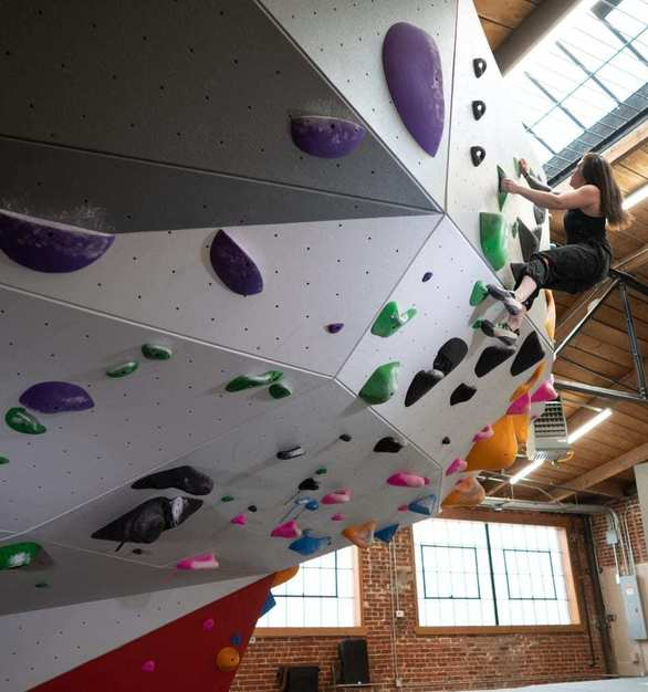 The Spot Denver Bouldering Gym took special consideration to preserve the historic character of the building with freestanding walls.