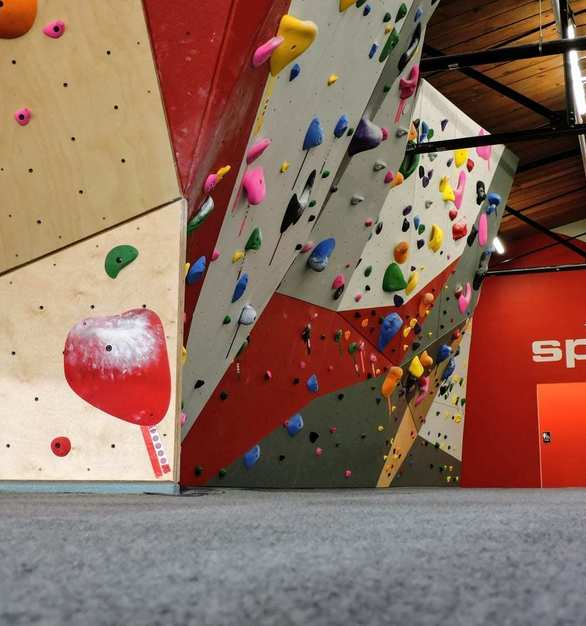 The Spot Denver Bouldering Gym features a panelized wall system and sections of natural wood coated in the most durable surface on the market.