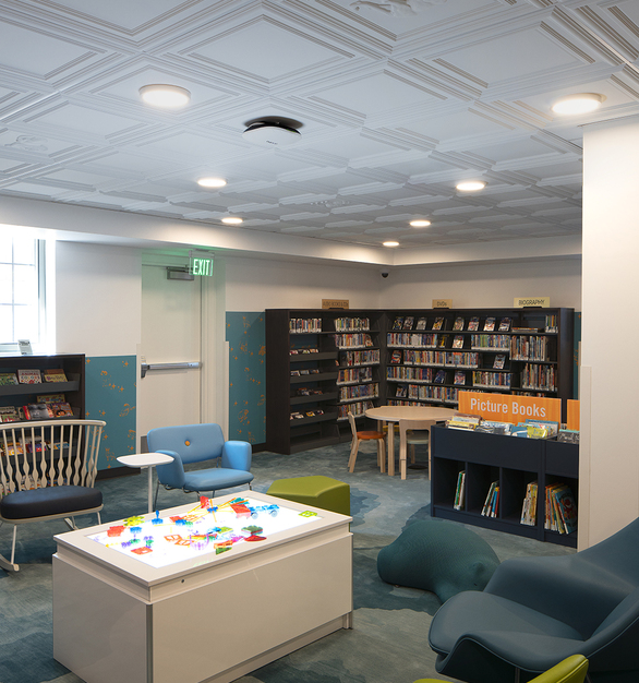 """Open since 1928, the historical Sprague Children's Library in Salt Lake City, UT features the Classic Panel for 9/16"""" Grid and 9 custom animal motifs. Make a game of spotting each animal above the reading lounge, or snack on animal crackers while relaxing with a good book. This whimsical design was a custom tile request."""