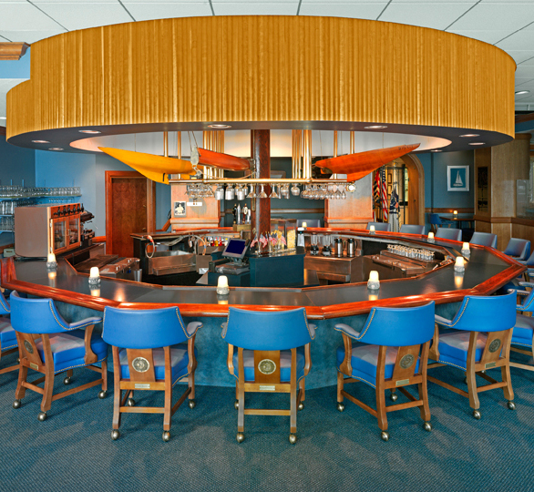 Stylish bar at St. Petersburg Yacht Club featuring Gasser Chair barstools.