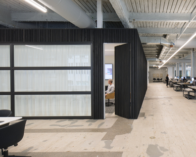 Large retractable overhead doors offer versatility and effective use of space to the MSR large office conference room.