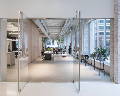 The main entrance to the MSR Design office featuring frameless architectural glass doors and windows that allows ample lighting for a welcoming atmosphere.
