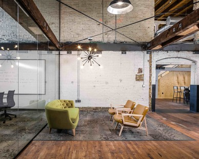 The welcoming open space and common area with comfortable seating and spacious atmosphere at Stahl Office Headquarters in Minneapolis, MN.