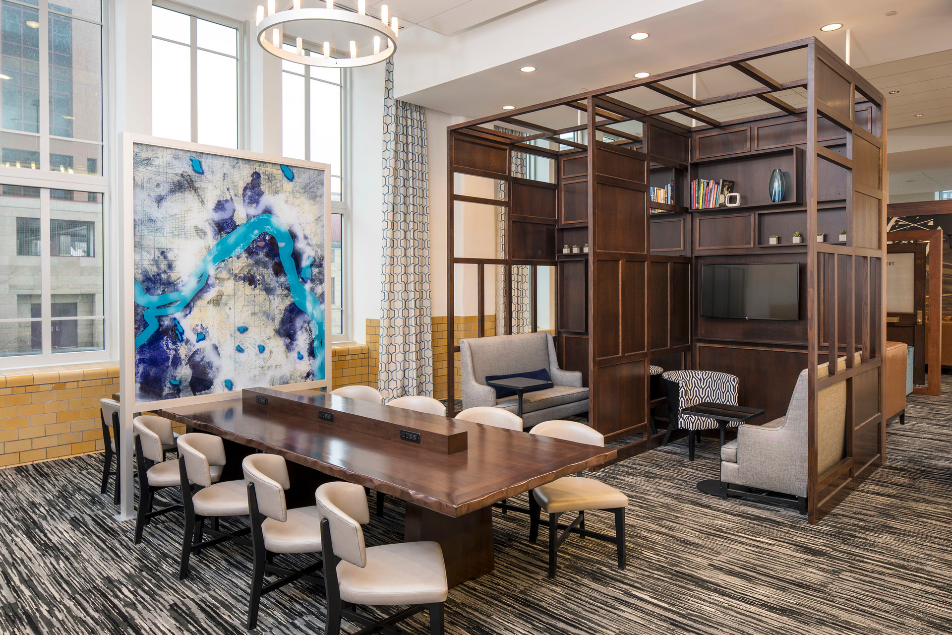 Different design elements create a striking common area at Custom House Hyatt Place in St. Paul, MN.