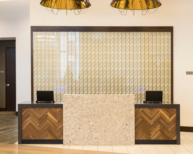 The renovated reception area blends the original building design with modern elements to create an updated vibrant look.