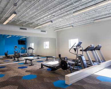 The Jet 55 office complex features many amenities including this modern office fitness center.
