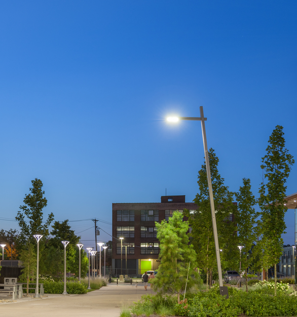 Illuminated outdoor pedestrian sidewalks and walkways feature our Tandem Tilt with a mounted LED luminaire.