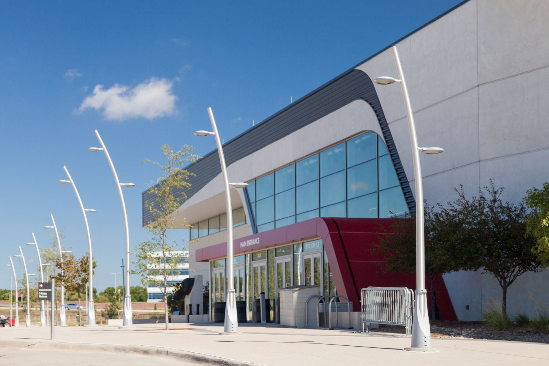 The exterior walkways at the Baxter Arena featuring our Flight Pole with mounted LED fixtures. These poles come in multiple luminaire arm mounting options.
