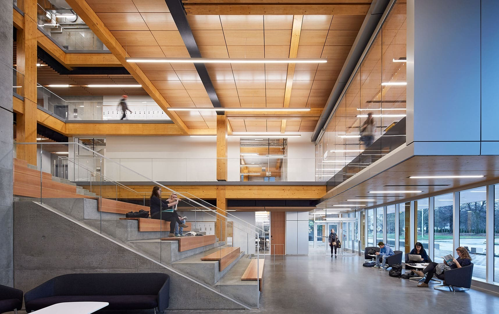 The student common area has lots of seating and natural light for the students to get together and study.