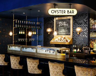 The Roxy Oyster Bar brings in elements of the water with custom bar lighting and mosaic custom tiles by STUDIO robert jamieson