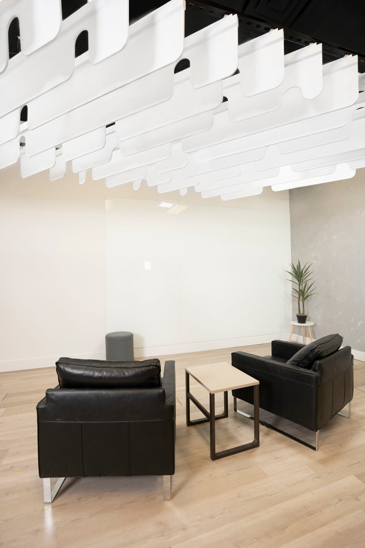 The Notch Acoustic Ceiling Baffles are made from 100% polyester fiber acoustic felt. The unique notch sculptural design enhances the workspace while providing ambient noise reduction within the room.