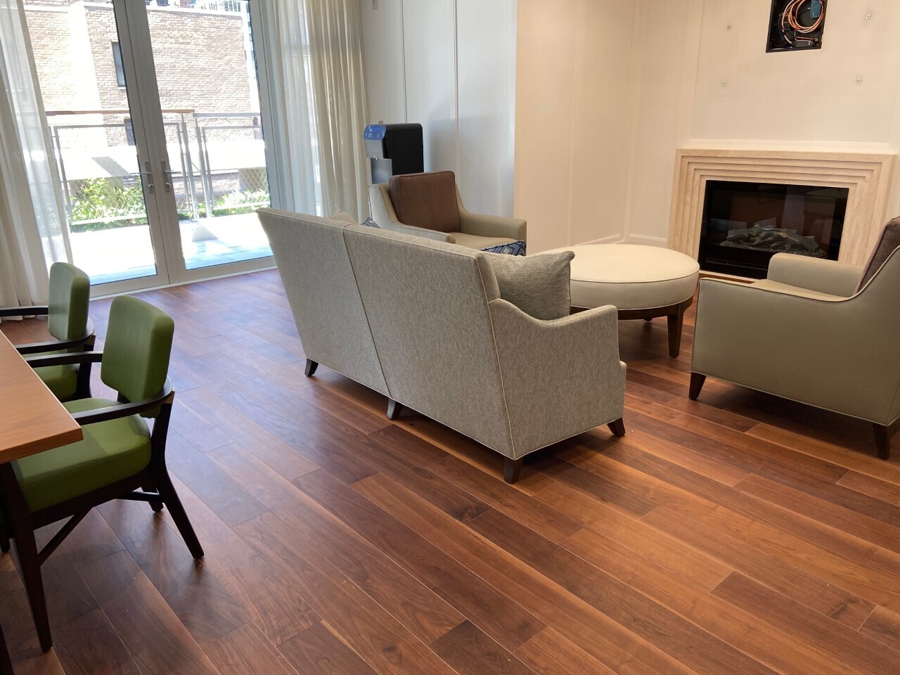 The gorgeous sitting room has engineered walnut flooring