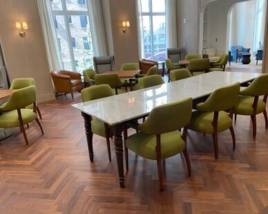 The beautiful engineered hardwood flooring is in a herringbone pattern in the dining room.
