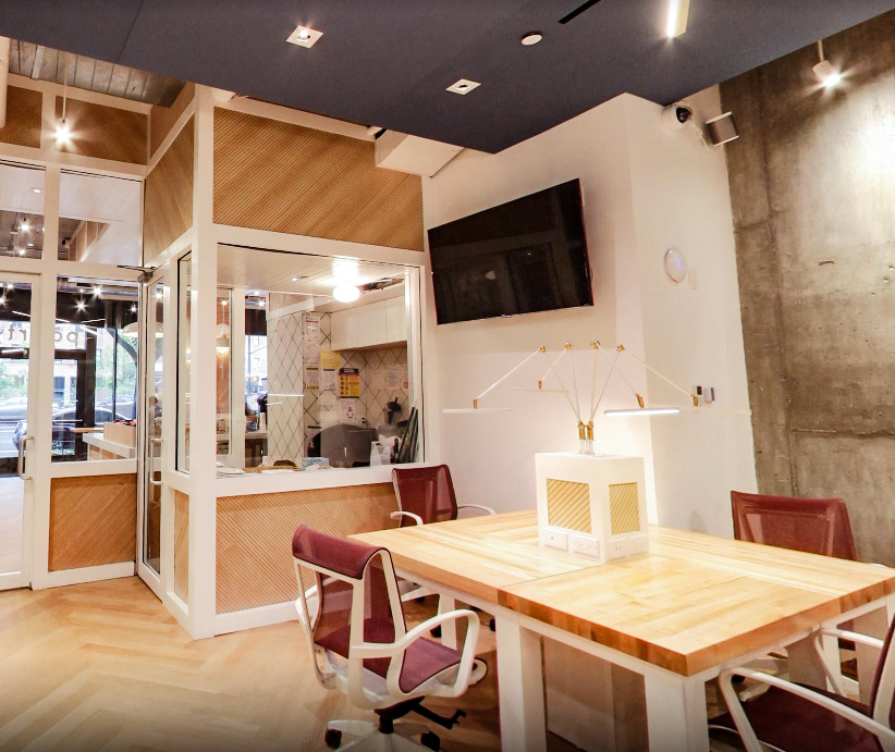 Modern coffee shop with Maple Veneer Tambour installed at a 45 degree angle - modern and eye catching!