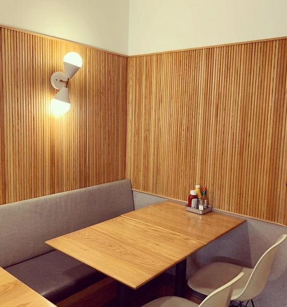 Schnipper restaurant sure knows how to show off the tambour wall panels, by Surfacing Solution.