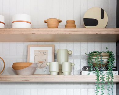 The beautiful solid wood tambour floating shelves were supplied by Surfacing Solution.