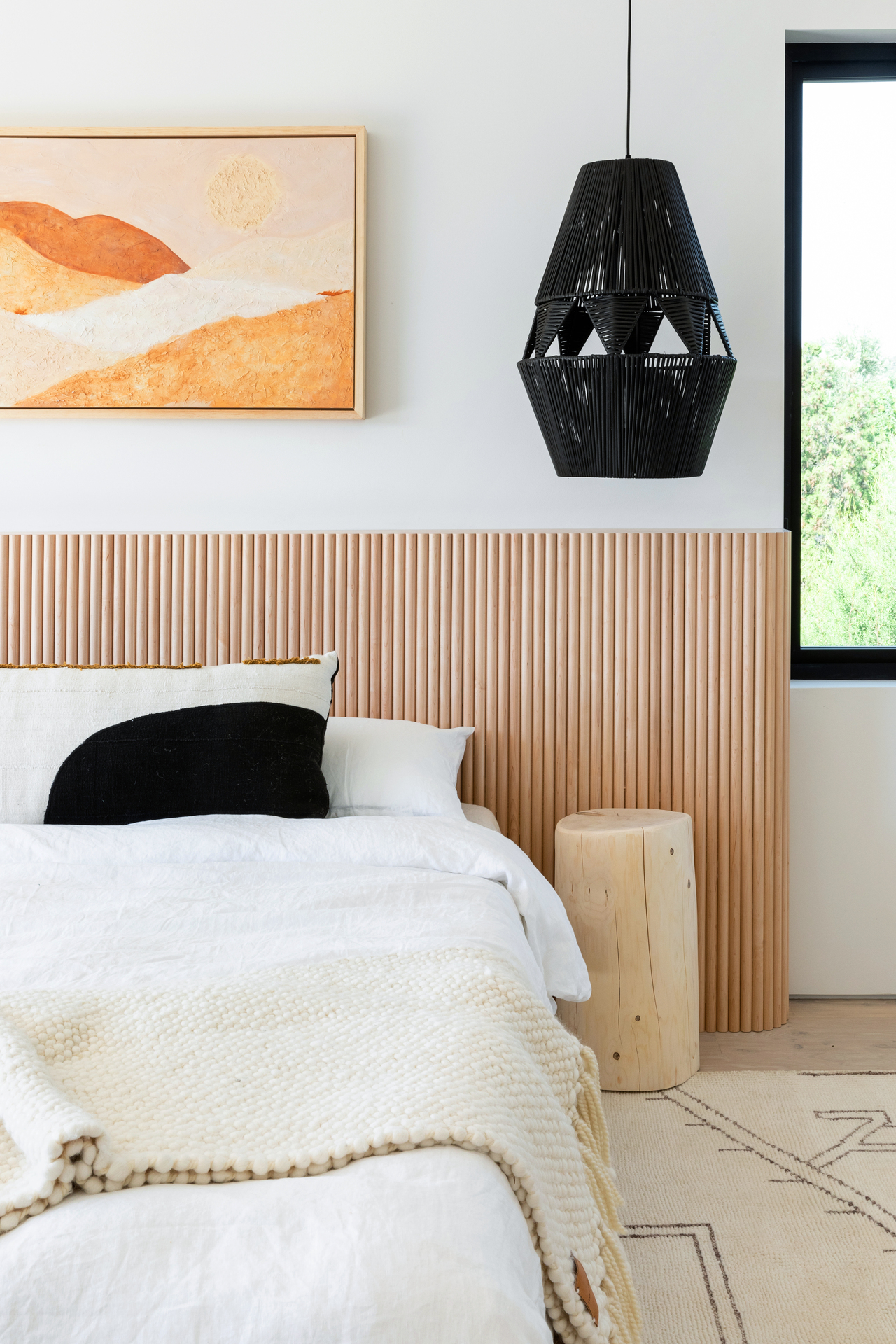 The solid Tambour Wood was used as a headboard in this beautiful bedroom design.