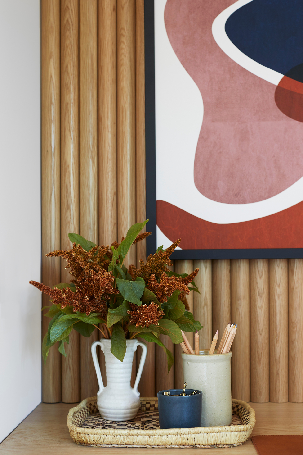 170 square foot room makeover using tambour wood wall panels as an accent.  Photographer: Jessica j Alexander Photography