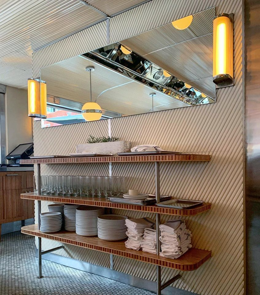 From the inlays to the diagonal accent, Empire Diner sure knows how to show off the tambour wall panels, by Surfacing Solution.