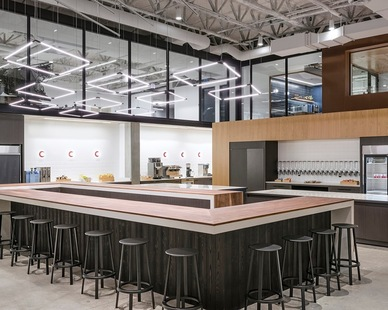 Boston Dynamics focuses on creating robots with advanced mobility, dexterity and intelligence.   When they built their new office, Bergmeyer used Pioneer Millworks sustainable wood products for many elements including stairs, floors, wall paneling, and a bar wrap.   Photos by Anton Grassl Photography.
