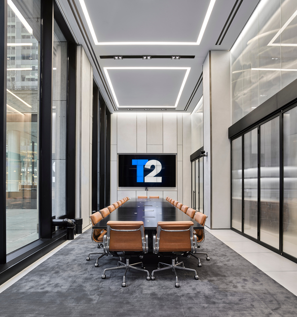 Houdini™ glass, an award-winning privacy glass, is installed in movable conference room partitions, gathering light from the opposing glazed façade and filtering it into the interior. Photo by Frank Oudeman.