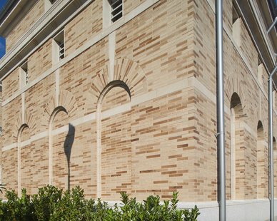 The Cathedral of the Most Sacred Heart of Jesus in Knoxville, TN is 28,000 square feet and features a lightly colored, smooth brick facade which gives an impression of limestone.  Photo by Kaminski Studios.