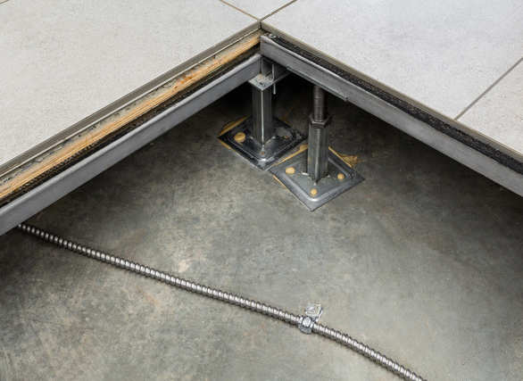 A raised access flooring system is used throughout the inside of the library to supply and connect the four main floors with power, data and air.