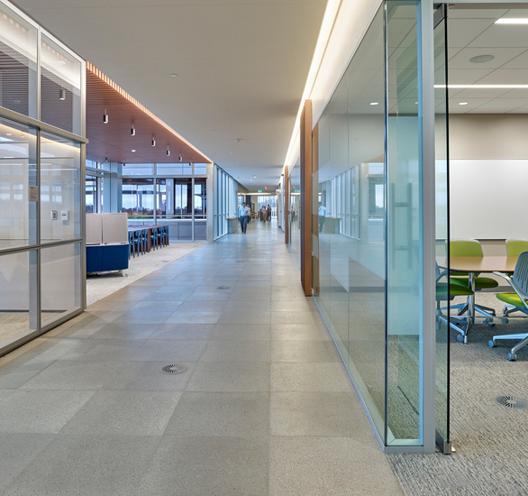 Raised access floors with high-end finishes that use an underfloor air distribution system has allowed CSC to create a stunning, future-proof environment for their new headquarters which will remain a model of sustainability for years to come.