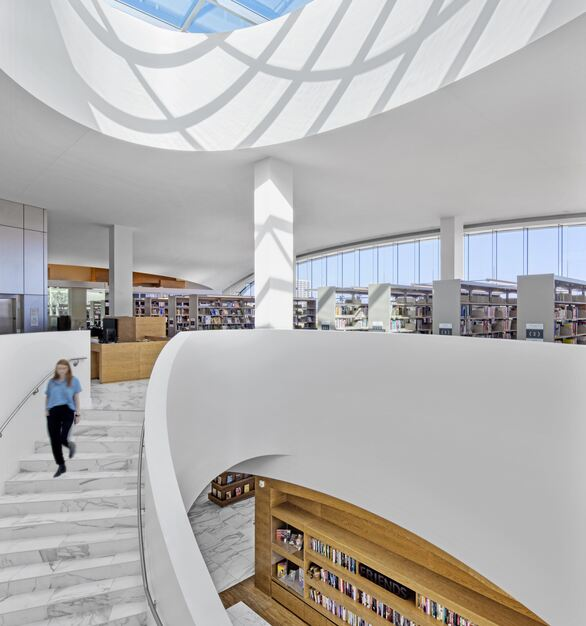 Stunning built-in white-oak shelving and marbled raised access floors flow throughout the bright and spacious Donald Dungan Library in Costa Mesa, California.