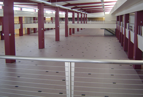 The underfloor air system has multiple air handlers that allow sections of the building to be turned off while maintaining an open floorplan. The underfloor wire and cable create a flexible layout for a future redesign. With a plug-n-play system, there is no rewiring necessary when associates and/or equipment is relocated.