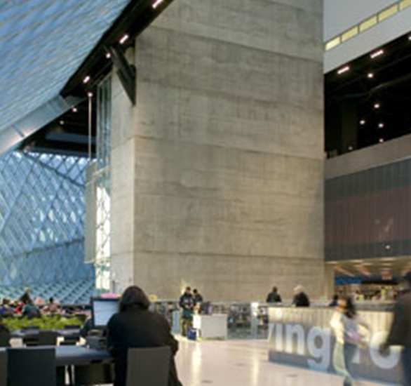 Some major sustainable strategies used in the Seattle Public Library were energy and water conservation techniques, recycled building materials, long-lasting, low-cost lighting with motion sensors to reduce costs, triple glazed glass, rainwater storage for outdoor irrigation, waterless urinals, and a Tate raised access floor just to name a few.
