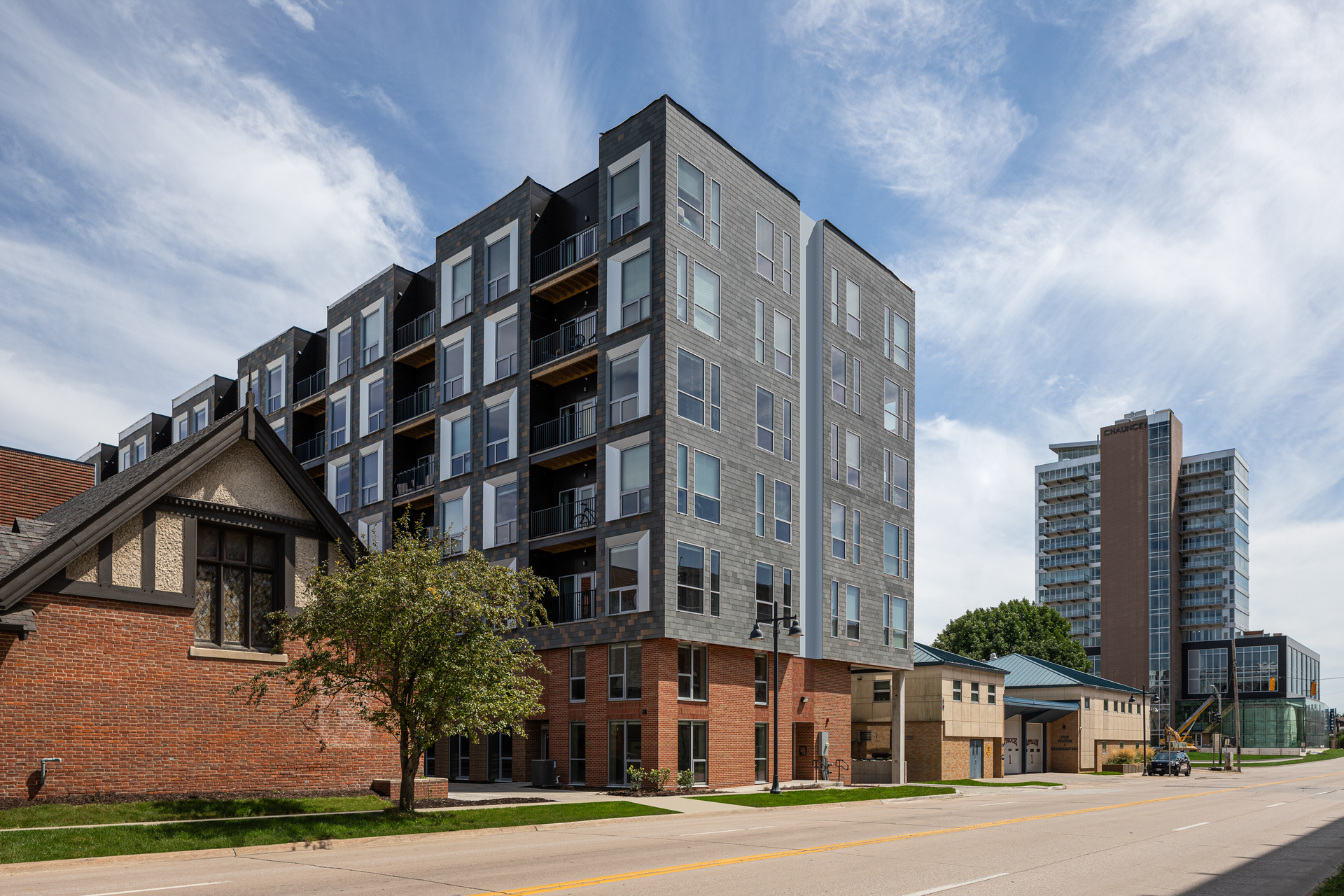 NeXclad True Facades in Antique Pewter offers a sleek streamlined look to this apartment complex.