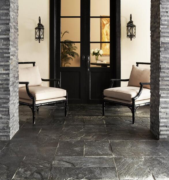 The floor uses Rock Ridge Rock Ridge Silver Gray Quartzite Tile in gray. The texture is perfect for outdoor, high-traffic areas.