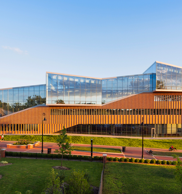 Kent State Center for Architecture and Environmental Design with the large glass windows and brick exterior was designed to connect the university and the recently revitalized downtown Kent.   The brick exterior was made of iron-spot brick facade and custom brick fins, fired locally in a bee-hive kiln.